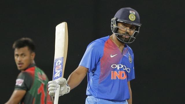 India's Rohit Sharma celebrates scoring fifty runs against Bangladesh during their second Twenty20 cricket match in Nidahas triangular series in Colombo, Sri Lanka, Wednesday