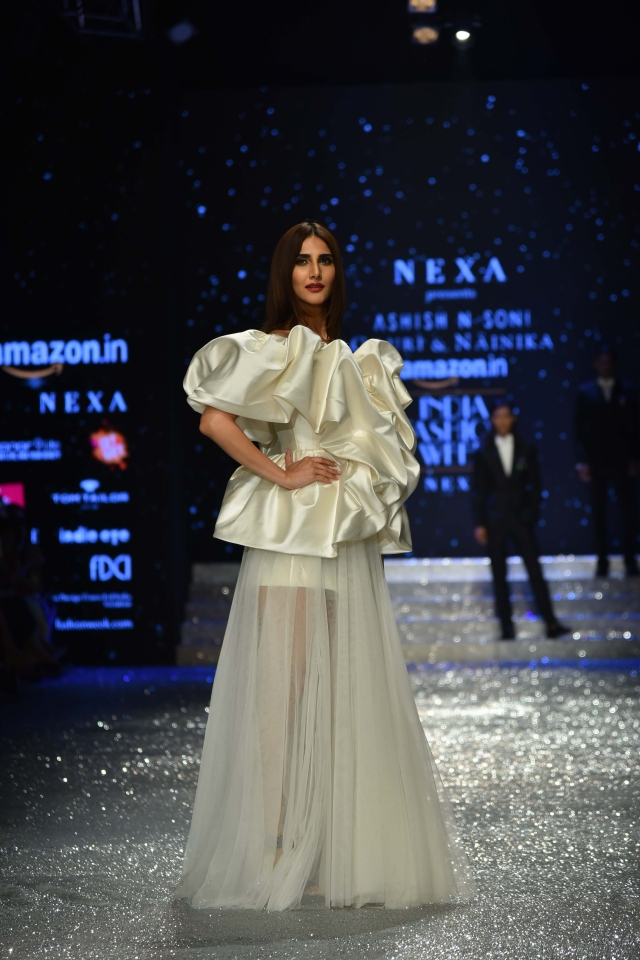 Vaani Kapoor looks like a vision in white as she dons asheer outfit with ruffles designed by Gauri and Nainika.
