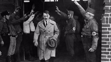 Adolf Hitler,  saluted as he leaves the Nazi party's Munich headquarters.