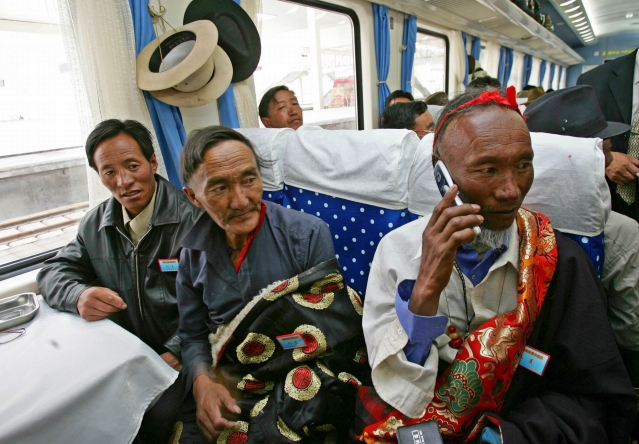 Passengers sit on board the first train at Lhasa railway station as it heads for Lanzhou in Gansu province 1 July 2006.