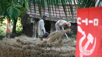22 November 2007: A communist trade union flag is seen at a house in Nandigram village. When the communist government of West Bengal state backed down on seizing their land for an industrial complex, it was seen as a victory for poor farmers.