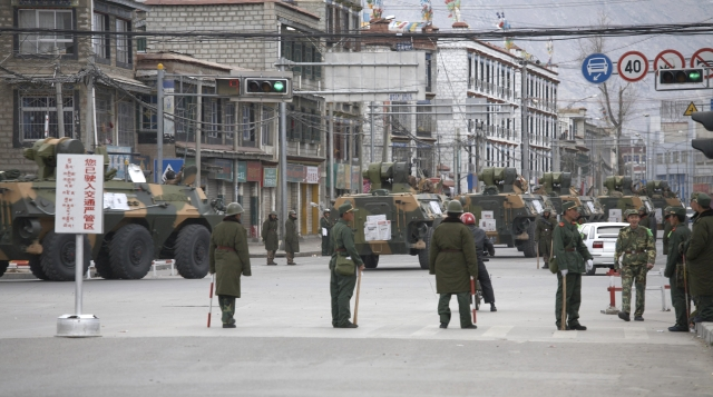 A convoy of armoured personnel carriers (APC) travel through the streets of Lhasa, Tibet March 15, 2008.