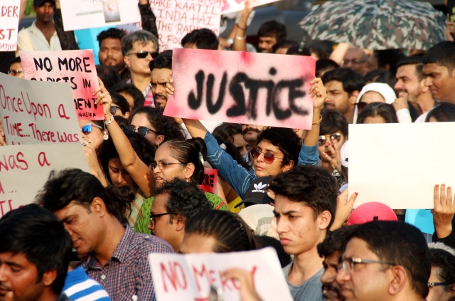 Kiran Rao holds up a placard demanding 'Justice' at the venue.