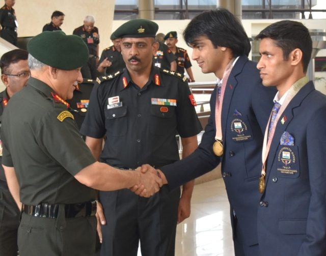 Army Chief General Bipin Rawat congratulates Naib Subedar Neeraj Chopra, Gold Medallist (Javelin Throw) and Havildar Gaurav Solanki, Gold medallist (Boxing) for their outstanding performance in the recently concluded Commonwealth Games (CWG) 2018; in New Delhi on 18 April 2018.