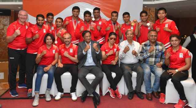 Boxers, who won medals at the Commonwealth Games, with President, Boxing Federation of India (BFI), Ajay Singh and others at a felicitation ceremony in New Delhi on 17 April.
