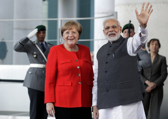 PM Narendra Modi with German Chancellor Angela Merkel in Berlin.