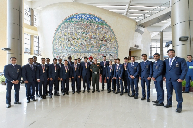 Army chief Bipin Rawat poses with Army's sportsmen who won medals in the Commonwealth Games 2018, at Manekshaw Centre in New Delhi on 18 April.