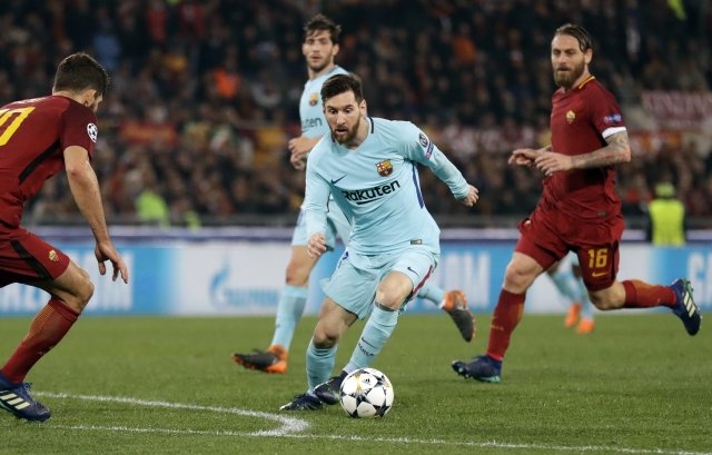 Barcelona's Lionel Messi wins with the ball during the Champions League quarter-final second leg soccer match.