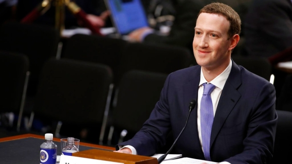 Facebook CEO Mark Zuckerberg smiles as he testifies before a joint hearing of the Commerce and Judiciary Committees on Capitol Hill in Washington.