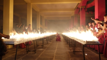 More than 200 Tibetans lit 1,30,232 candles, one for every Tibetan living in exile.