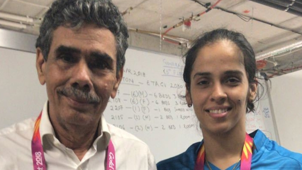File picture of Saina Nehwal and her father.