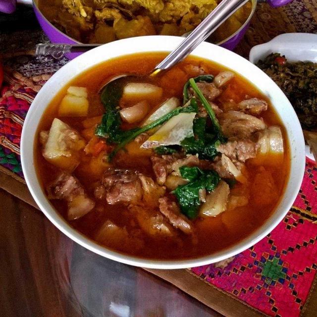Naga style plain pork boiled with seasonal herbs.