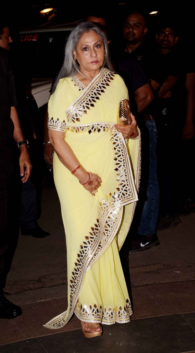 Jaya Bachchan in a yellow saree at the wedding.