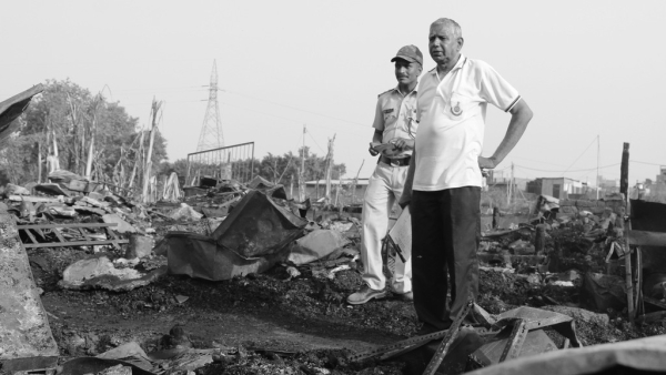 Delhi Police officials at the site of the fire.