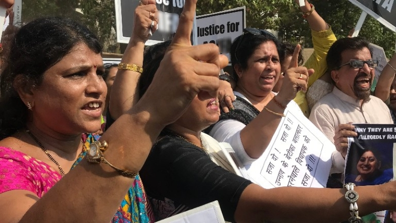 Image result for pics of rape protestor