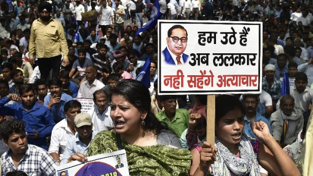Members of the Dalit community raise slogans during the Bharat Bandh against the alleged dilution of SC/ST Act in New Delhi, on 2 April.