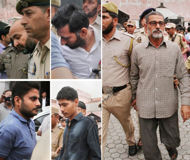 Prime accused Sanji Ram (R) and other accused of Kathua rape and murder case, being produced in District Court in Kathua, about 85km from Jammu on Monday, 16 April.