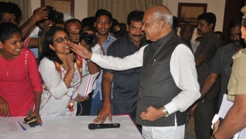 Why did Tamil Nadu Governor Banwarilal Purohit pat journalist Lakshmi Subramanian's cheek?