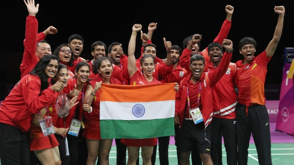Saina Nehwal, Kidambi Srikanth, Ashwini Ponnappa celebrate India's victory in the mixed team badminton final at the 2018 Commonwealth Games.