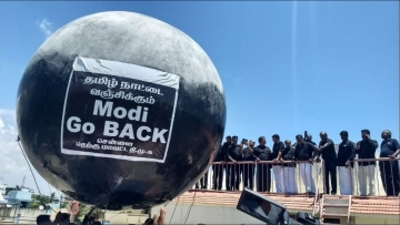 DMK floats a black balloon in Chennai with the slogan 'Modi Go Back', to protest PM Narendra Modi's visit to Tamil Nadu.