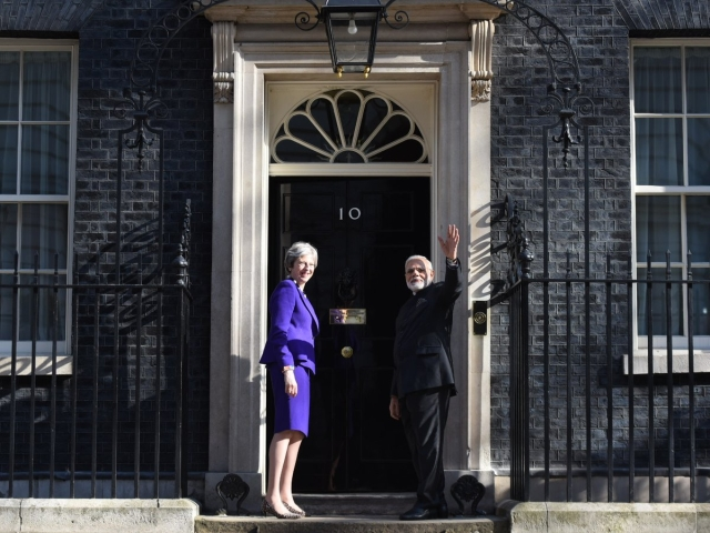 PM Modi meets UK PM Theresa May in London.