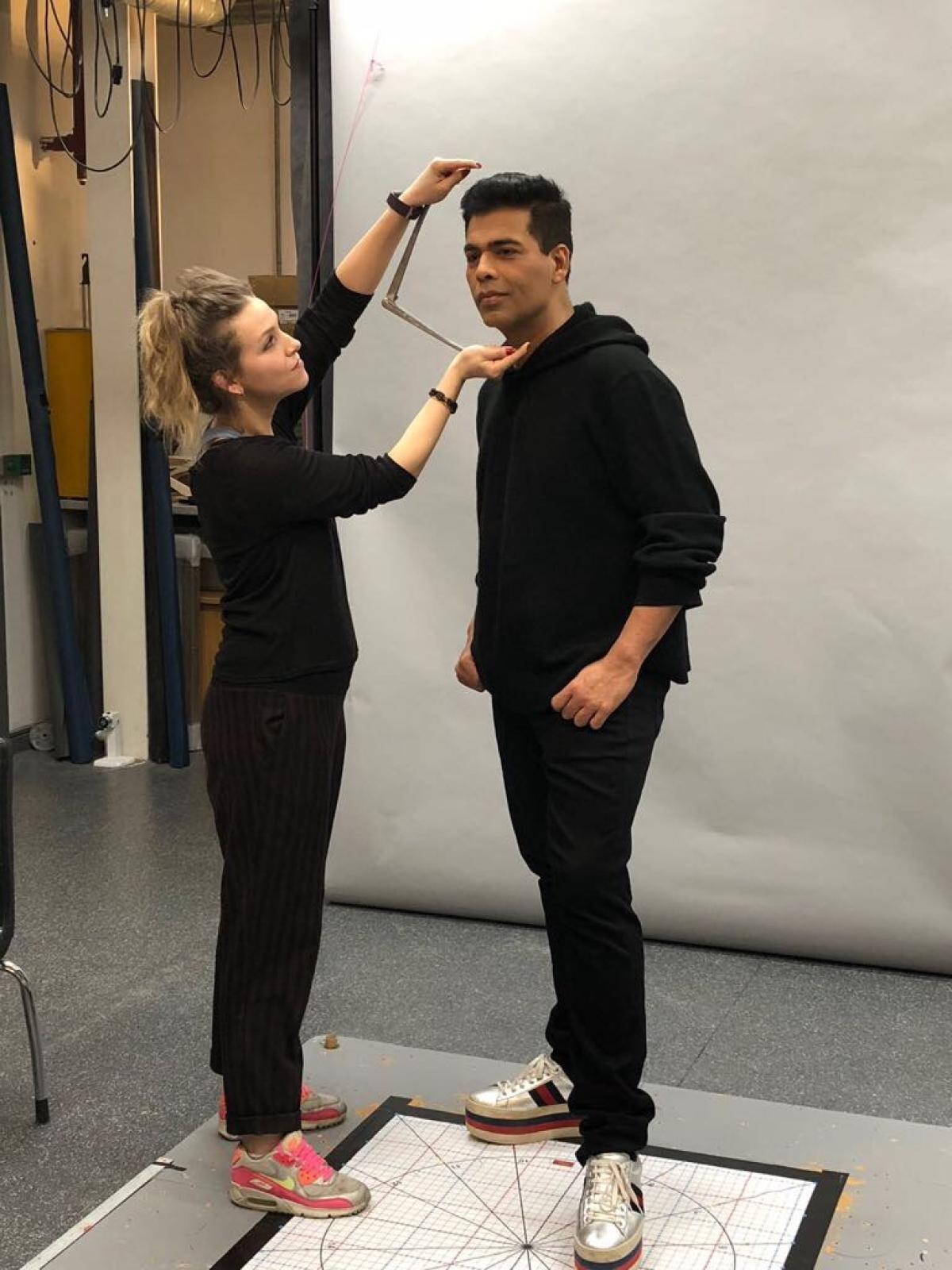 Karan Johar gets measured.