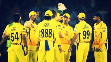 The Chennai Super Kings players celebrate a wicket.