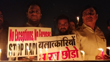Hundreds gathered on 12 April midnight in New Delhi to protest against the Kathua and Unnao rape cases.
