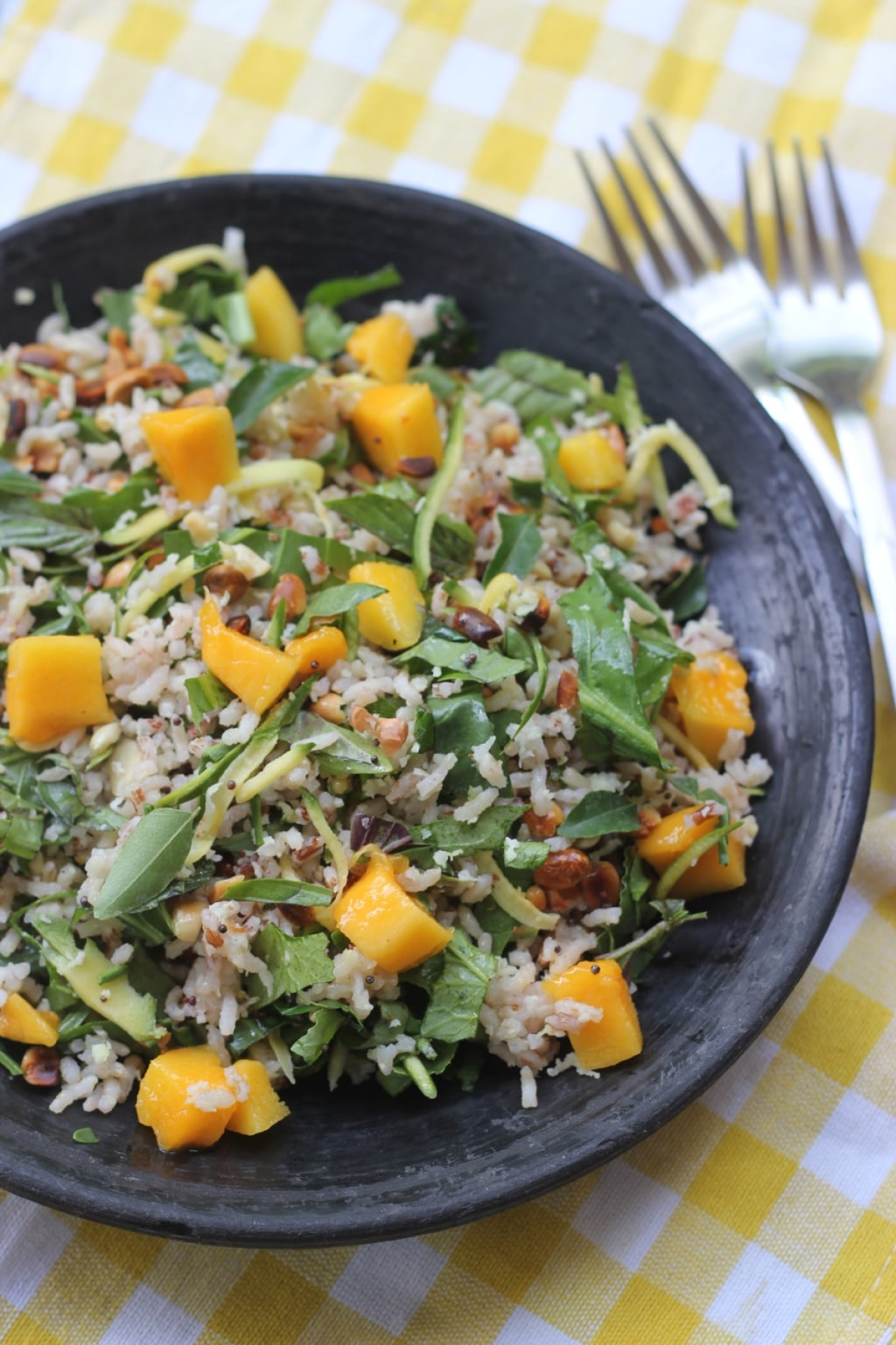 Cold red rice salad with green and ripe mangoes, coconut and a spicy dressing.