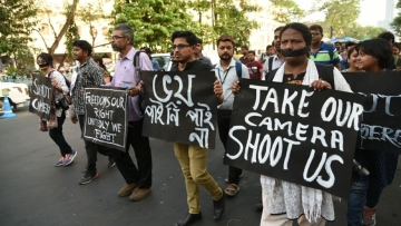 Journalists take out a protest march after a photojournalist was stripped and beaten in Kolkata.