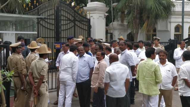 HD Kumaraswamy waiting outside the Raj Bhavan.