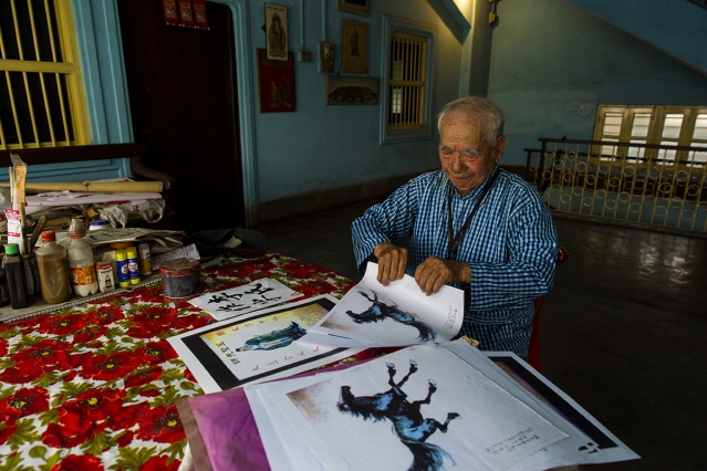 Lee Kar Shong, 88, a Chinese-Indian painter and calligrapher, works at his home in the new China town of Tangra. Shong was born in Kolkata but speaks only Chinese.