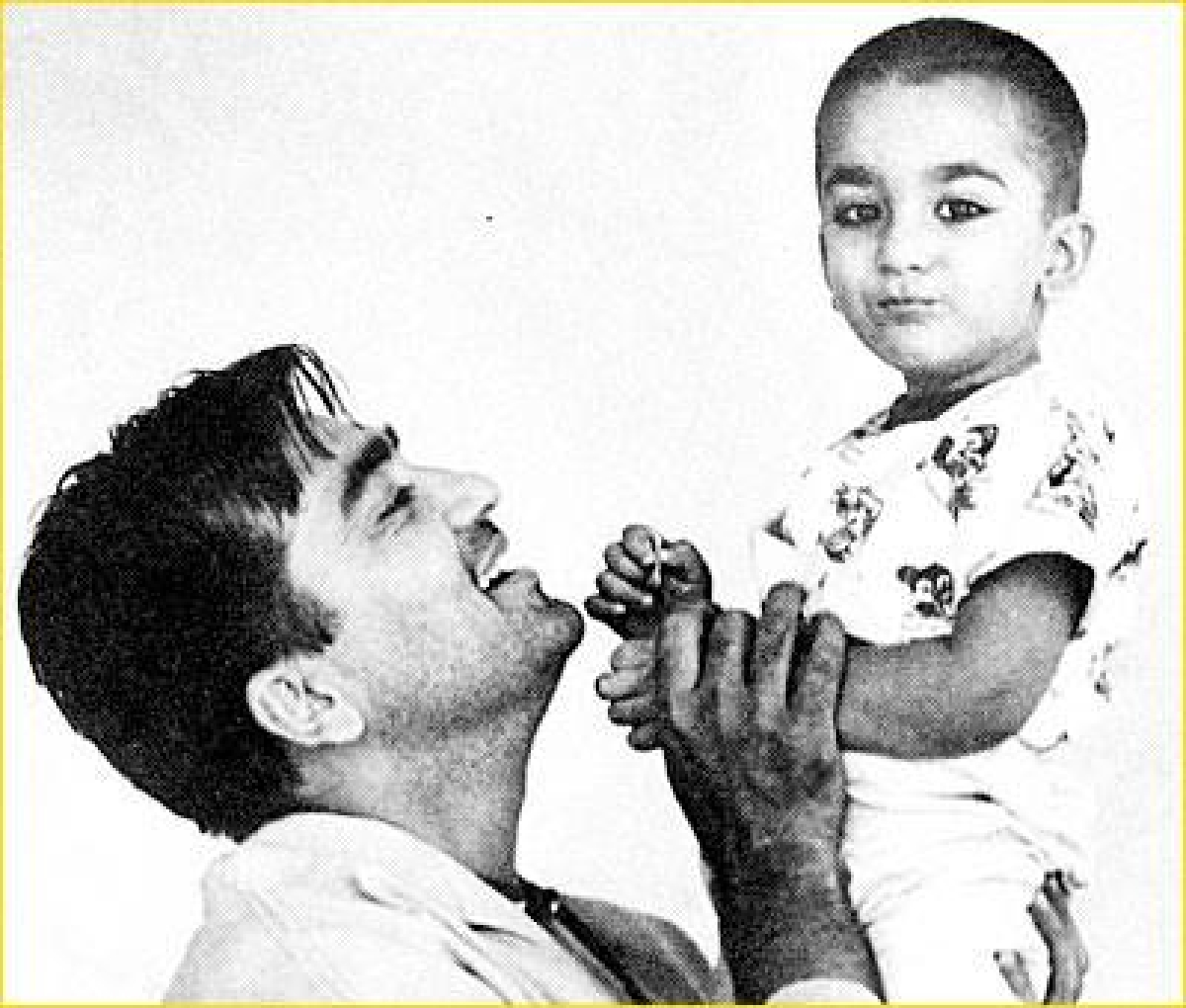 Sunil plays with a baby Sanjay Dutt.