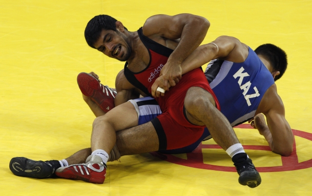 Sushil Kumar fights Leonid Spiridonov of Kazakhstan during their 66 kg men's freestyle wrestling bronze medal match at the Beijing Olympic Games.
