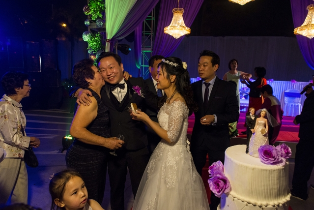 Chinese-Indians congratulate Winston Leong, 30, and Justine Lee, 25, at a reception party following their wedding. Though born Christians, Leong and Lee worship  Lord Viswakarma (the Hindu god of engineering).