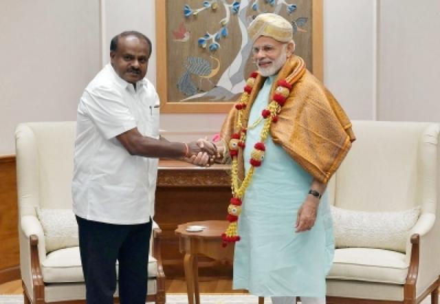 Karnataka Chief Minister H.D. Kumaraswamy calls on Prime Minister Narendra Modi, in New Delhi on 28 May 2018.