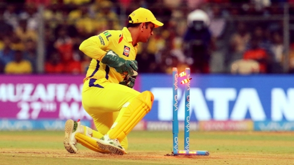 MS Dhoni completes a stumping.