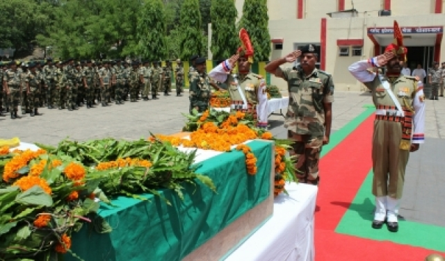 Jammu: Soldiers pay tribute to BSF constable Sitaram Upadhyay who was killed in Pakistan firing on the international border (IB) in Jammu and Kashmir in Jammu on May 18, 2018. (Photo: IANS)