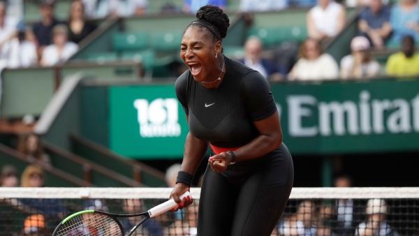 Serena Williams of the US celebrates winning her first round match of the French Open tennis tournament against Krystina Pliskova.