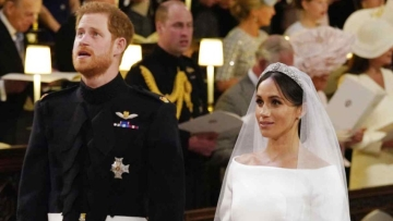 Prince Harry and Meghan Markle during their wedding service at St George's Chapel in Windsor Castle in Windsor, near London, England, Saturday, 19 May, 2018.