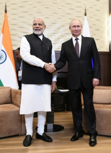 Sochi: Prime Minister Narendra Modi meets Russian President Vladimir Putin in Sochi, Russia on May 21, 2018. (Photo: IANS/MEA)