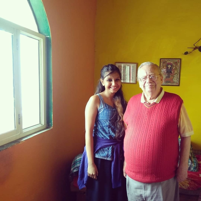 A photograph with Ruskin Bond, near the window he writes beside.