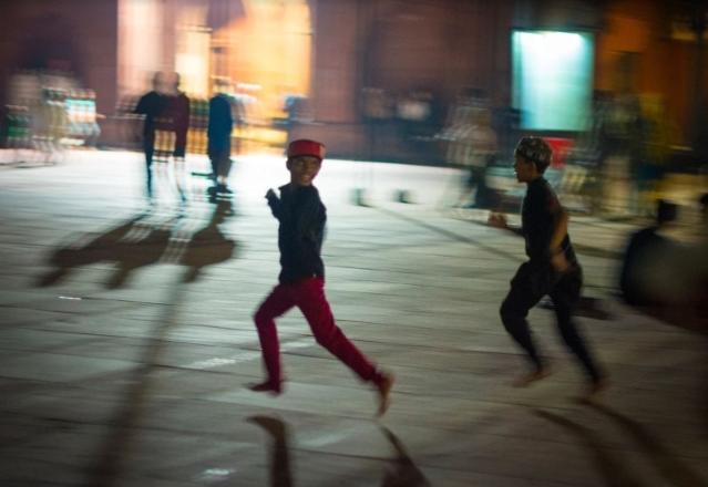 Children running inside the Jama Masjid compound.