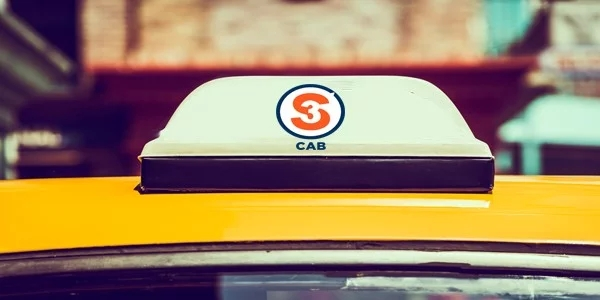 A taxi shows the logo of the new startup called S3 Cab launched in Mumbai.