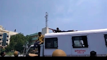 A video taken during the Sterlite protests shows at least two policemen were seen getting on top of a van and taking aim at protesters to shoot them down.