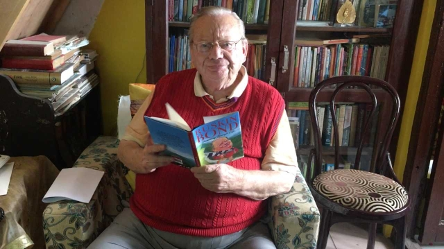 Ruskin Bond, in his couch where he reads every afternoon.