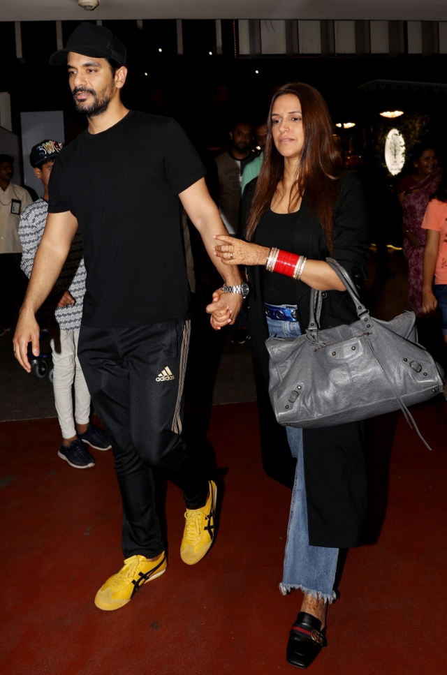 Neha Dhupia and Angad Bedi arrive in Mumbai.