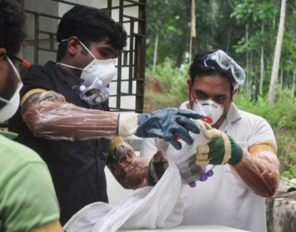 Kozhikode: Medical staff wear protective suit to avoid contacting Nipah virus that has claimed 12 lives in Kerala till now, in Kozhikode on May 25, 2018. (Photo: IANS)