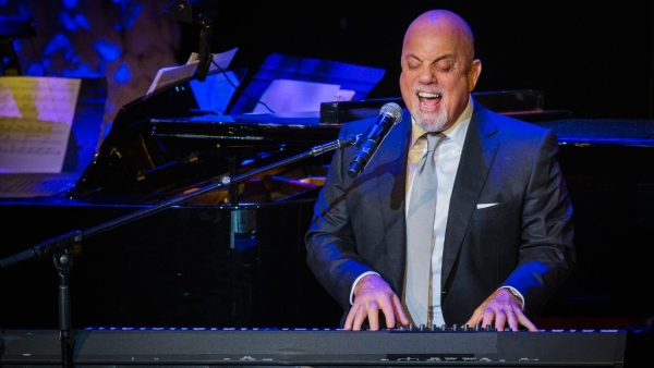 Billy Joel performs after accepting an award at the American Society of Composers, Authors and Publishers in 2014.