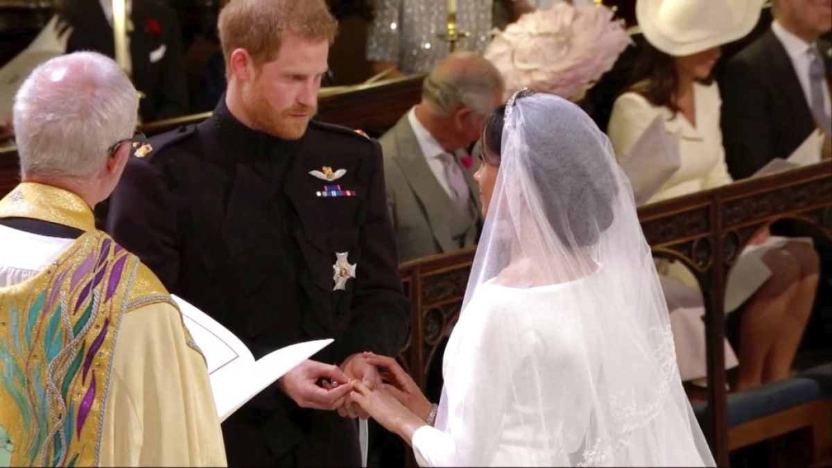 In this frame from video, Britain's Prince Harry places a ring on Meghan Markle's finger during their wedding ceremony at St. George's Chapel in Windsor Castle in Windsor, near London, England, Saturday, 19 May, 2018.